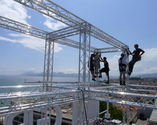 Installing truss grid on Grand Hotel Roof , Cannes